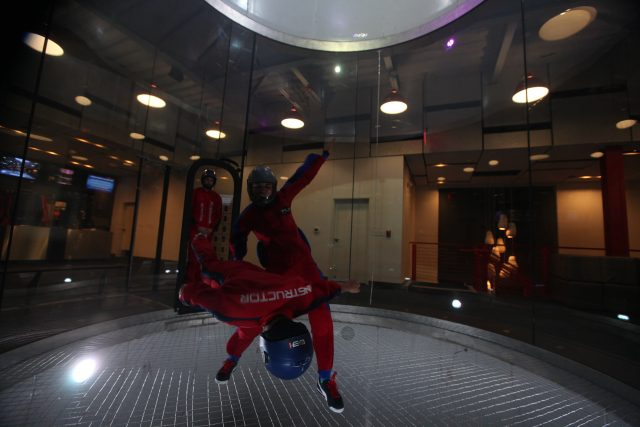 Michelle flying in the wind tunnel as an instructor at iFly Dallas.
