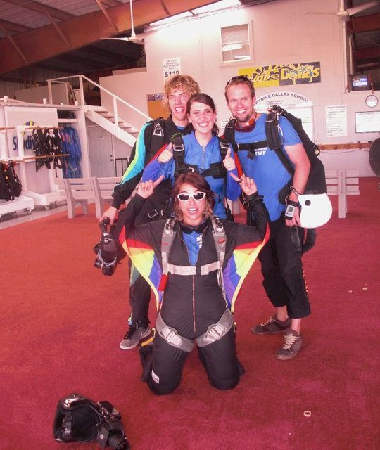 Michelle at Skydive Dallas posing in her camera suit before a jump.