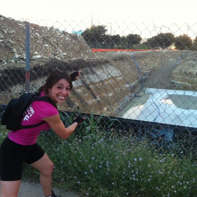 Michelle excitedly points at the construction site for iFly Dallas.